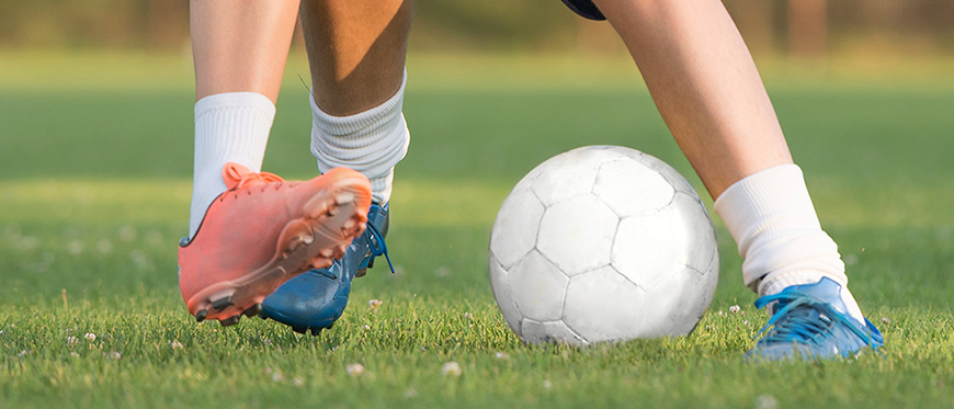 Close up of feet playing soccer