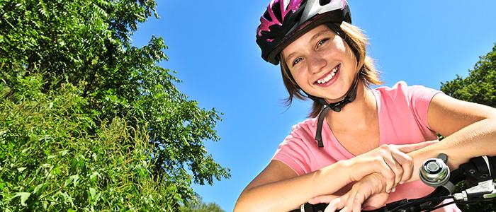 Girl wearing bike helmet