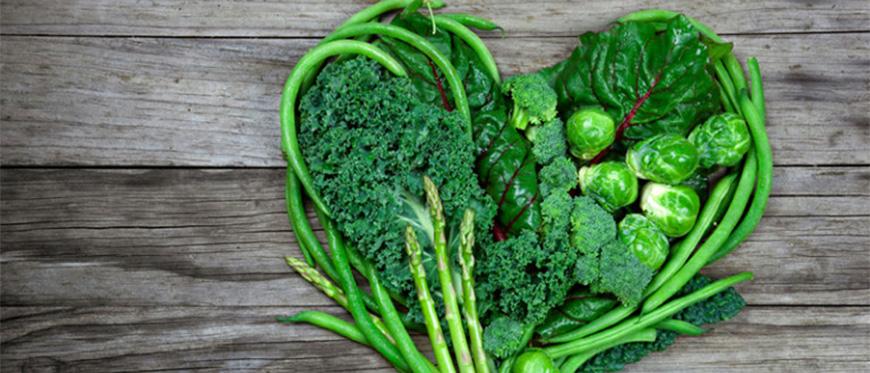 Green vegetables arranged in a heart shape