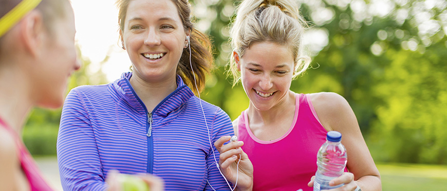Three women talking after a run