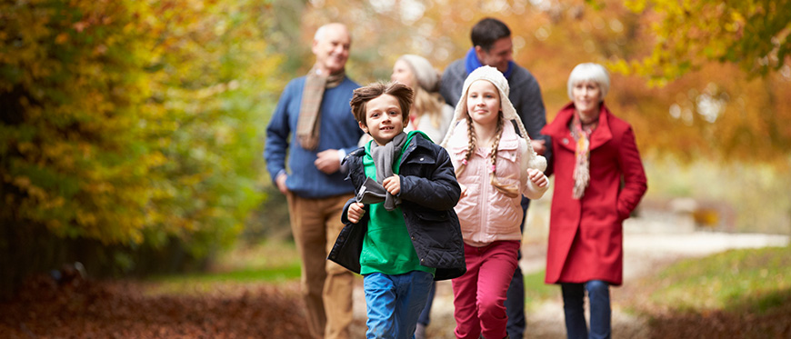 Multi-generational family out walking in fall