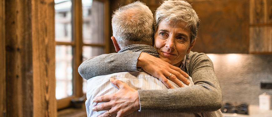 Older woman hugging her husband