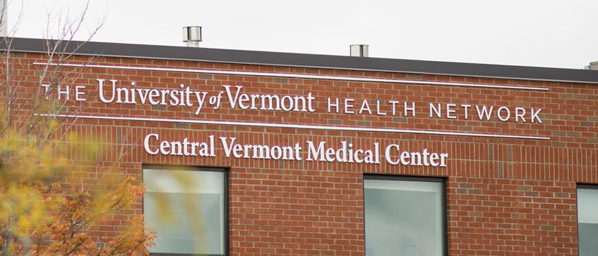Exterior photo of UVM Health Network - CVMC sign on outside of CVMC hospital building