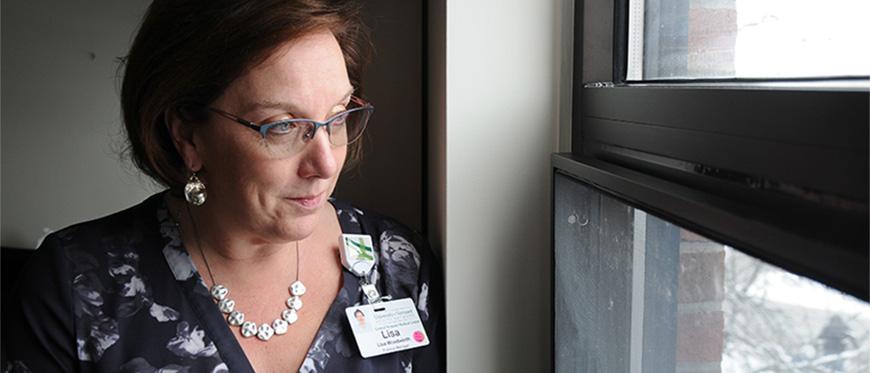 Lisa Woodridge looking out window of hospital