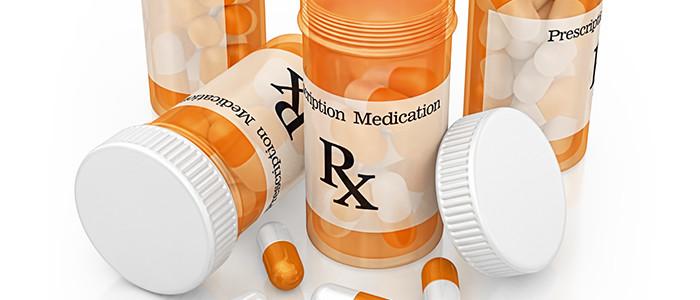 A group of pill bottles.