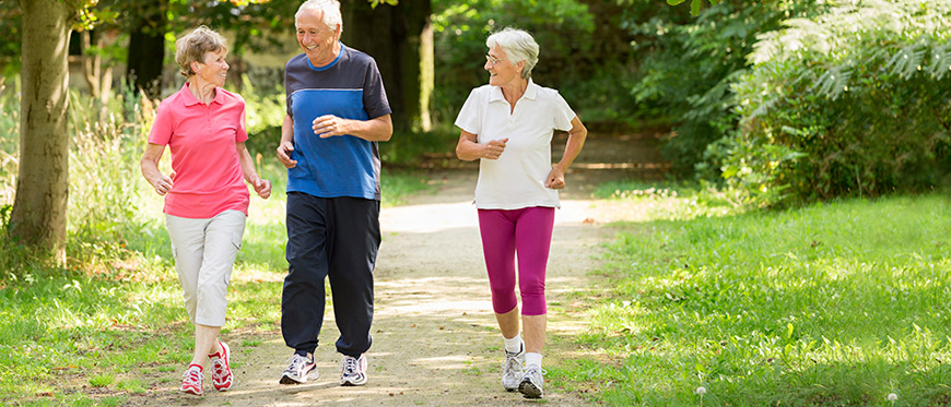 Senior man and two woman walking for exercise