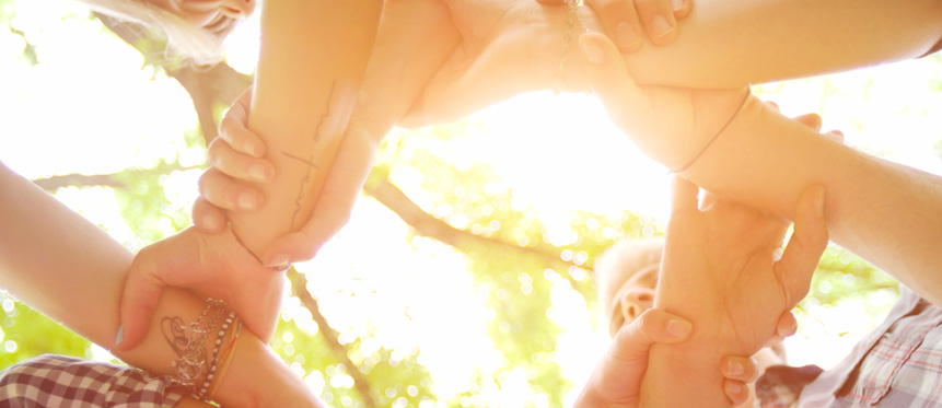 Sunlight shining through locked arms