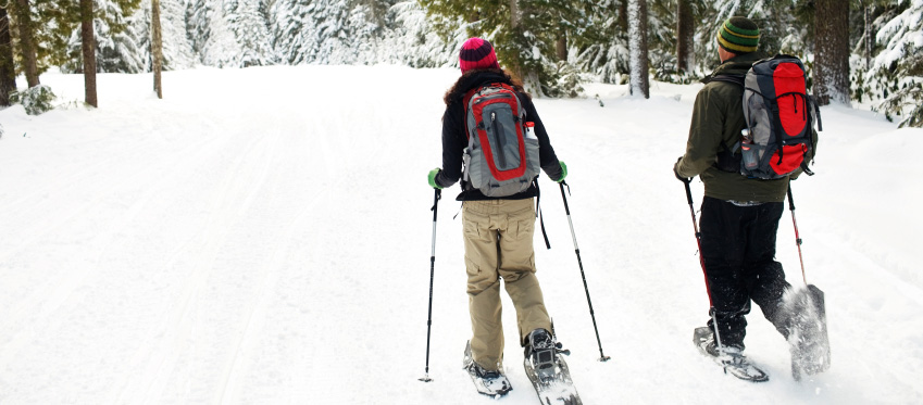 Couple out snowshoeing