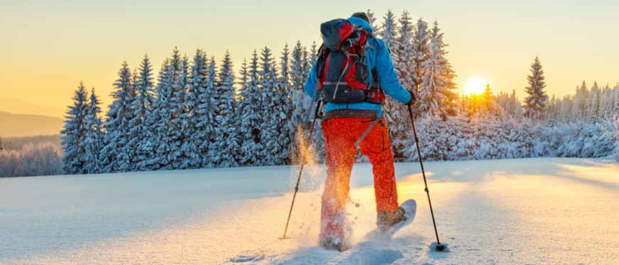 Man snowshoeing with a backpack