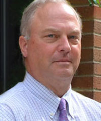 John R. Brumsted, MD