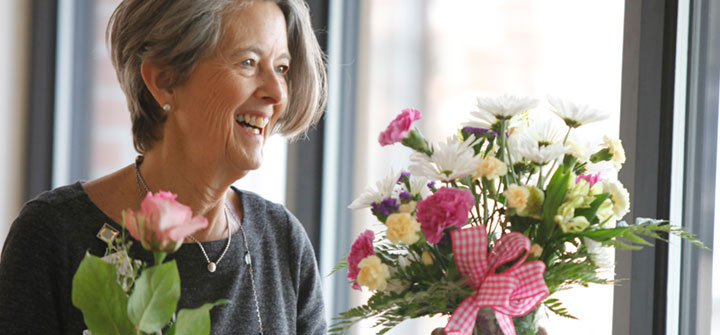 Visitor bringing flowers to patient
