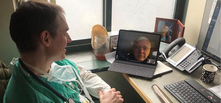 Dr. Jeremiah Eckhaus conducting video visit with patient