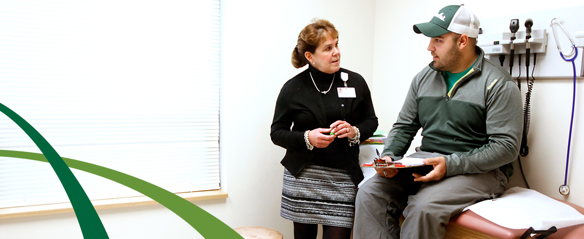 Cancer trial coordinator discussing options with patient
