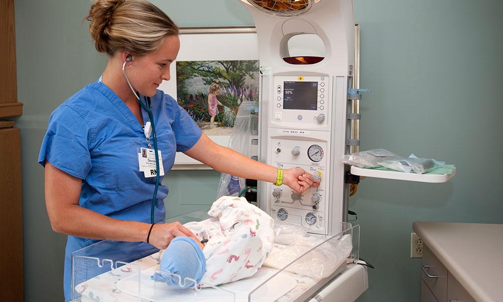 Nursing checking newborn's heart