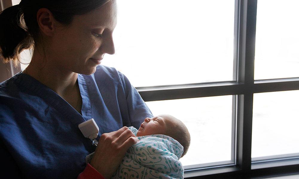 Nurse holding newborn