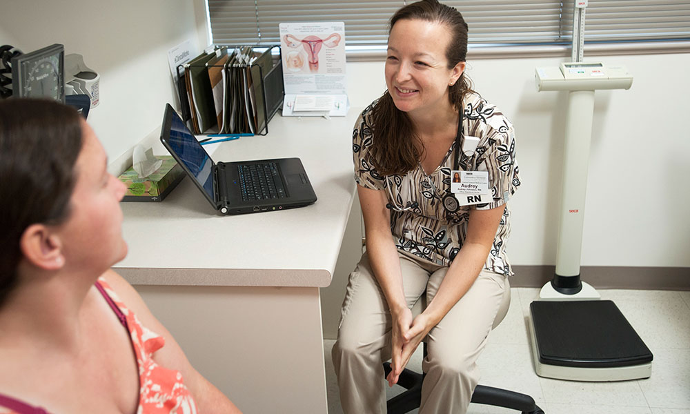 Nurse consulting with patient during prenatal visit