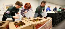 CVMC and VYCC staff handing out food at mobile food pantry